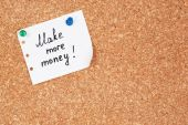 """Paper sheet with inscription """"Make more money"""" on wooden background — Stock Photo"""