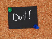 "Motivating paper sheet with inscription ""Do it"" on wooden background — Stock Photo"