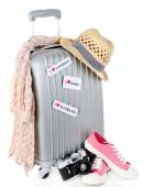 Travel suitcase, converse, photo camera and hat isolated on white — Stock Photo
