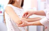 Vaccination in human hand — Stock Photo