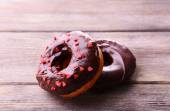 Delicious donuts with glaze on table close-up — Stock Photo