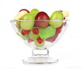Mix of fruit in glass saucer isolated on white — Stock Photo