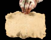 Hand of mummy with old paper — Stock Photo