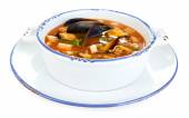 Tasty mussel soup isolated on white — Stock Photo