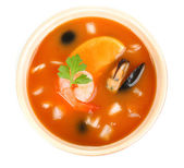 Tasty mussel soup with shrimps in bowl isolated on white — Stock Photo