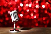 Silver microphone on red background — Stock Photo
