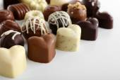 Delicious chocolate candies isolated on white — Stock Photo