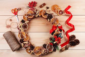 Christmas wreath with materials for decorating — Stock Photo