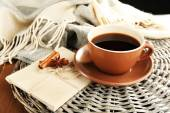 Cup of coffee with envelopes on wicker stand on wooden table background — Stock Photo