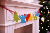 Christmas garland near fireplace — Stock Photo