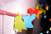 Christmas garland near fireplace — Stock Photo