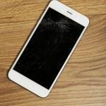 Broken iPhone on wooden background — Stock Photo #61220987