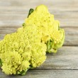 Romanesco broccoli on wooden table — Stock Photo #61227091