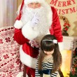 Santa Claus with little girl — Stock Photo #61228893