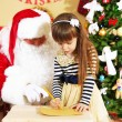 Santa Claus with little girl — Stock Photo #61228907