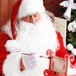 Santa Claus sitting in comfortable rocking chair — Stock Photo #61229167