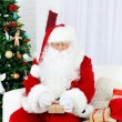Santa Claus with gift boxes — Stock Photo #61229253
