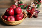 Christmas apples on wooden table — Stock Photo
