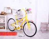 Yellow retro bicycle in spacious bright room — Stock Photo
