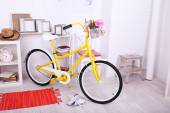 Yellow retro bicycle in spacious bright room — Photo