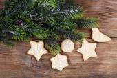 Gingerbread cookies with Christmas decoration on wooden table background — Stock Photo