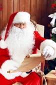Santa Claus with list of presents — Stock Photo