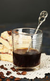 Glass of espresso and tasty homemade pie on wooden table — Stok fotoğraf
