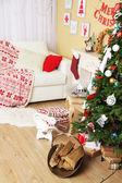 Beautiful Christmas interior with sofa, decorative fireplace and fir tree — Stock Photo