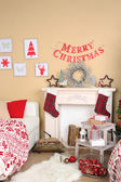 Beautiful Christmas interior with sofa, decorative fireplace and fir tree — Foto de Stock