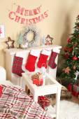 Beautiful Christmas interior with sofa, decorative fireplace and fir tree — Photo