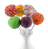 Sweet cake pops in vase isolated on white — Stock Photo