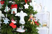 Christmas handmade decorations on Christmas tree  on light background — Stock Photo