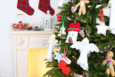 Christmas handmade decorations on Christmas tree  on light home interior background — Stock Photo