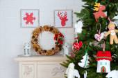 Christmas handmade decorations on Christmas tree  on light home interior background — Foto de Stock