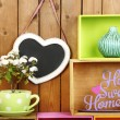 Beautiful colorful shelves with different home related objects on wooden wall background — Stock Photo #61303393