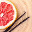 Dried grapefruit with vanilla beans on wooden background — Stock Photo #61303425