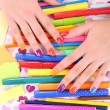 Multicolor female manicure with markers and pencils on bright background — Stock Photo #61304187