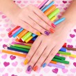 Multicolor female manicure with markers and pencils on bright background — Stock Photo #61304197