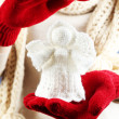 Knitted Christmas angel in female hand, close-up — Stock Photo #61304271