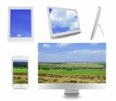 Monitor, laptop, tablets and phone with nature wallpaper — Stock Photo