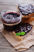 Delicious black currant jam on table close-up — Stock Photo