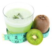 Glass of fresh green juice with centimeter and kiwi isolated on white — Stock fotografie