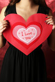 Girl holding Valentine card — Stock Photo