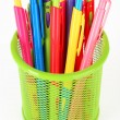 Colorful pens in green metal vase isolated on white background — Stock Photo #61311741