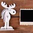 Blank photo frame and Christmas decor on wooden table background — Stock Photo #61312451
