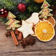 Gingerbread cookies with slices of orange and Christmas decoration on wooden table background — Stock Photo #61313981