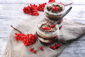 Delicious dessert in jars on table close-up — Foto Stock