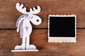 Blank photo frame and Christmas decor on wooden table background — Stock Photo