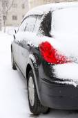 Black car covered with snow, outdoors — Stockfoto