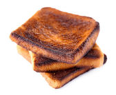 Burnt toast bread isolated on white background — Foto Stock